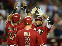 Jun. 20, 2012; Phoenix, AZ, USA; Arizona Diamondbacks outfielder Justin Upton (right) is congratulated by Chris Young after hitting a three run home run in the fifth inning against the Seattle Mariners at Chase Field.  Mandatory Credit: Mark J. Rebilas-