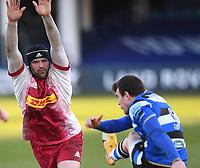 6th February 2021; Recreation Ground, Bath, Somerset, England; English Premiership Rugby, Bath versus Harlequins; Ben Spencer of Bath kicks under pressure from Matt Symons of Harlequins