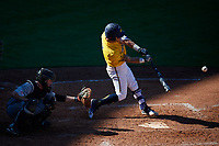 Michigan Wolverines catcher Marcus Chavez (12) at bat in front of catcher Jon Rosoff (7) during a game against Army West Point on February 17, 2018 at Tradition Field in St. Lucie, Florida.  Army defeated Michigan 4-3.  (Mike Janes/Four Seam Images)