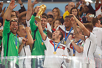 Mario Gotze of Germany celebrates winning the FIFA World Cup trophy with team mates