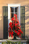Exterior Christmas tree decoration with bows.