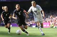 Kelly SMITH of Great Britain rounds Ria PERCIVAL of New Zealand - Great Britain Women vs New Zealand Women - Womens Olympic Football Tournament London 2012 Group E at the Millenium Stadium, Cardiff, Wales - 25/07/12 - MANDATORY CREDIT: Gavin Ellis/SHEKICKS/TGSPHOTO - Self billing applies where appropriate - 0845 094 6026 - contact@tgsphoto.co.uk - NO UNPAID USE.