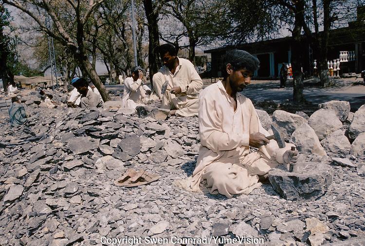 Stone mortar manufactured in the suburb of Peshawar, Pakistan