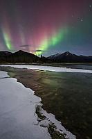 Colorful aurora over the Koyukuk River in Alaska's Brooks Range mountains.