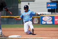 Erie SeaWolves Chace Numata (25) slides into third base during an Eastern League game against the Akron RubberDucks on June 2, 2019 at UPMC Park in Erie, Pennsylvania.  Erie defeated Akron 8-5 in eleven innings in the second game of a doubleheader.  (Mike Janes/Four Seam Images)