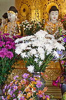Myanmar, Burma.  Offerings at a Buddhist Shrine at the Zayar Thein Gyi Nunnery, near Mandalay.
