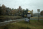 November 4, 2008. Mebane, NC.. Constant rains did not keep North carolina voters from the polls. Including early voting, NC was on its way to a record turnout for highly contested state and national races.. Roadside campaign signs..