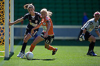 MELBOURNE, AUSTRALIA - DECEMBER 4: Tameka Butt of the Roar and Stephanie Catley of the Victory compete for the ball in round 5 of the Westfield W-league match between Melbourne Victory and Brisbane Roar on 4 December 2010 at AAMI Park in Melbourne, Australia. (Photo Sydney Low / asteriskimages.com)