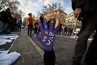 """Rome, 25/01/2020. Today, Artisti Resistenti Roma and Prima gli esseri umani held a flash mob for Peace in Piazza dell'Esquilino (1.). <br /> From the event Facebook page: «Gino Strada [2.]: """"We cannot still conceive a world without war"""".<br /> We have always been against all types of war, abuse and abuse against humanity and against the devastation of planet earth, torn by wars, massive deforestations, pollution and violence. We are here to show our strong support for all those peoples who still today experience situations of armed conflict generated by a thirst for power and money. We ask aloud that the shame Security Decrees [3.] be repealed, in defense of the peoples who fight for their freedom and their rights! [...]».<br /> <br /> Footnotes & Links:<br /> 1. http://bit.do/fqysS<br /> 2. http://bit.do/fqy4i<br /> 3. 15.07.2019 - Manifestazione Contro il Decreto Sicurezza Bis - Demo Against Security Decree Bis http://bit.do/fqyxV"""