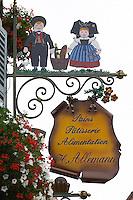 patisserie shop wrought iron sign h allemann eguisheim alsace france