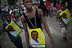 "© Remi OCHLIK/IP3 - Port au Prince on 2010 december 9 - PORT-AU-PRINCE -- Clashes and shooting were reported Thursday in Haiti's capital for a second day as demonstrators staged a march to protest what they said was election fraud in the Nov. 28 presidential elections..The protests broke out Wednesday after election officials announced Tuesday night that two candidates had made it into a runoff: Mirlande Manigat, a former first lady, and Jude CÈlestin, the candidate of current President RenÈ PrÈval's party. Out of the running was Michel ""Sweet Micky'' Martelly, who early results had shown running second. -  Celestin supporters demonstrate in Bel Air district."