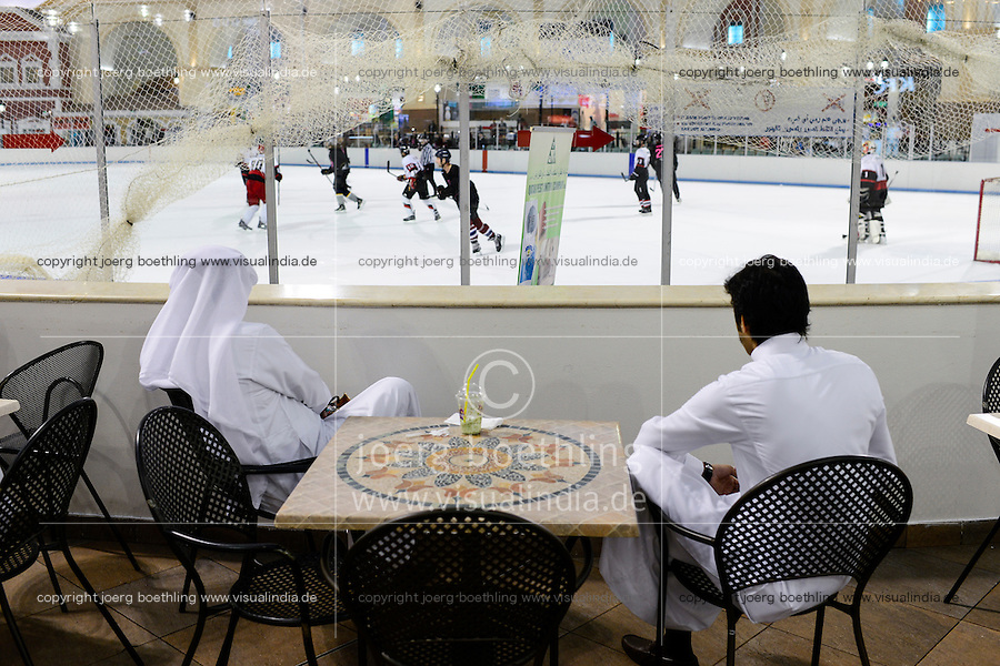 QATAR, Doha, Aspire Zone, Villaggio shopping mall with ice skating ground, Qatari sheikhs observing ice hockey game / KATAR, Doha, shopping mall mit Schlittschuhbahn, Eishockey Spiel