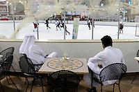QATAR, Doha, Aspire Zone, Villaggio shopping mall with ice skating ground, Qatari sheikhs observing ice hockey game / KATAR, Doha, shopping mall mit Schlittschuhbahn, Eishockey Spiel