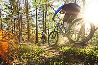 Two mountain bikers Jon Bokrantz and Jon Lindgren ride a single track trail through the Änggårdsbergen Nature Reserve, Gothenburg, Sweden