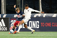 FOXBOROUGH, MA - OCTOBER 09: Justin Rennicks #12 of New England Revolution II and Modesto Mendez #15 of Fort Lauderdale CF battle for the ball during a game between Fort Lauderdale CF and New England Revolution II at Gillette Stadium on October 09, 2020 in Foxborough, Massachusetts.