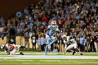 CHAPEL HILL, NC - NOVEMBER 02: Dyami Brown #2 of the University of North Carolina breaks a tackle on a long run during a game between University of Virginia and University of North Carolina at Kenan Memorial Stadium on November 02, 2019 in Chapel Hill, North Carolina.