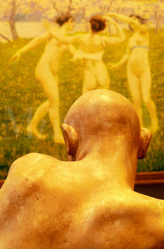 Italy, Venice. Ca'Pesaro, Gallery of Modern Art. Vew of the back of a sculpture's head and a painting of three girls dancing