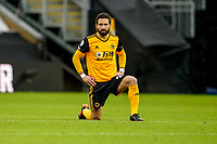 7th February 2021; Molineux Stadium, Wolverhampton, West Midlands, England; English Premier League Football, Wolverhampton Wanderers versus Leicester City; João Moutinho of Wolverhampton Wanderers takes a knee against racism before the game starts