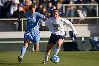 Notre Dame Fighting Irish midfielder Courtney Rosen (14) is chased by North Carolina Tar Heels midfielder Yael Averbuch (17). The North Carolina Tar Heels defeated the Notre Dame Fighting Irish 2-1 during the finals of the NCAA Women's College Cup at Wakemed Soccer Park in Cary, NC, on December 7, 2008. Photo by Howard C. Smith/isiphotos.com