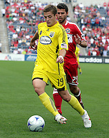 Columbus Crew midfielder Robbie Rogers (19) controls the ball in front of Chicago Fire midfielder Peter Lowry (29).  The Columbus Crew tied the Chicago Fire 2-2 at Toyota Park in Bridgeview, IL on September 20, 2009.