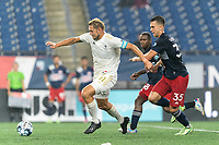 FOXBOROUGH, MA - AUGUST 5: Robert Kristo #11 of North Carolina FC attempts to control the ball as Colin Verfurth #35 of New England Revolution II pressures during a game between North Carolina FC and New England Revolution II at Gillette Stadium on August 5, 2021 in Foxborough, Massachusetts.