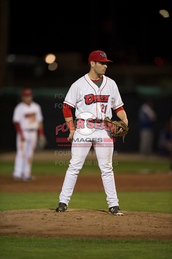 Orem Owlz relief pitcher Kyle Tyler (21) looks in for the sign during a Pioneer League game against the Ogden Raptors at Home of the OWLZ on August 24, 2018 in Orem, Utah. The Ogden Raptors defeated the Orem Owlz by a score of 13-5. (Zachary Lucy/Four Seam Images)