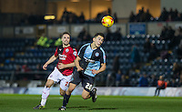 Luke O'Nien of Wycombe Wanderers turns Mitch Hancox of Crawley Town during the Sky Bet League 2 match between Wycombe Wanderers and Crawley Town at Adams Park, High Wycombe, England on 28 December 2015. Photo by Andy Rowland / PRiME Media Images
