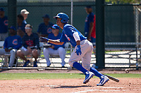 Chicago Cubs outfielder Roberto Caro (13) starts down the first base line during an Extended Spring Training game against the Los Angeles Angels at Sloan Park on April 14, 2018 in Mesa, Arizona. (Zachary Lucy/Four Seam Images)