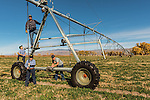 Robert Dowers and his sons, Todd, Kyle, and Nolan, work on the hay pivot. Triple D Ranch in Dyer, Nevada