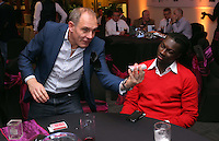 Pictured: Bafetimbi Gomis entertained by a magician <br /> Re: Swansea City FC Christmas party at the Liberty Stadium, south Wales, UK.