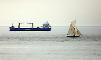 Pictured: A small sailing boat goes past the BBC Karmara boat off the coast of Mumbles, near Swansea, south Wales, UK. Friday 06 May 2016<br /> Re: Warm and sunny weather has been forecast for most of the UK.