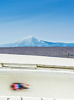 5 December 2014: John Fennell, sliding for Canada, zooms in a blur of speed through Curve Number 14 on his first run, ending the day with a 19th place finish and a combined 2-run time of 1:44.174 in the Men's Competition at the Viessmann Luge World Cup, at the Olympic Sports Track in Lake Placid, New York, USA. Mandatory Credit: Ed Wolfstein Photo *** RAW (NEF) Image File Available ***