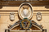 Mdina, Malta. Cathedral of Saint Paul, Built 1702. Coat of Arms above Main Doorway.  The cathedral is said to sit on the site of the house of the head man of Mdina, who was visited by St. Paul.