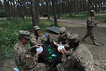 "American soldiers with the 15th Engineer Battalion play cards during down time in their resting quarters at the Drawsko Pomorskie Training Area in Konotop, Poland on June 9, 2015.  NATO is engaged in a multilateral training exercise ""Saber Strike,"" the first time Poland has hosted such war games, involving the militaries of Canada, Denmark, Germany, Poland, and the United States."