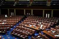Papers and gas masks are left behind after House of Representatives members left the floor of the House chamber as protesters try to break into the chamber at the U.S. Capitol on Wednesday, Jan. 6, 2021, in Washington. (AP Photo/J. Scott Applewhite)