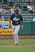 Andy Marte (8) of the Reno Aces takes his lead off of third base against the Salt Lake Bees at Smith's Ballpark on May 4, 2014 in Salt Lake City, Utah.  (Stephen Smith/Four Seam Images)