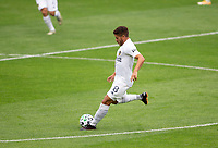 LOS ANGELES, CA - OCTOBER 25: Jonathan dos Santos #8 of the Los Angeles Galaxy passes a ball during a game between Los Angeles Galaxy and Los Angeles FC at Banc of California Stadium on October 25, 2020 in Los Angeles, California.