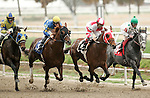 January 2010: Friesan Fire and Shaun Bridgmohan lead into the first turn of the Louisiana Handicap at the Fairgrounds in New Orleans, La.