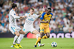 Vinicius de Oliveira Franco (r) of APOEL FC battles for the ball with Toni Kroos of Real Madrid during the UEFA Champions League 2017-18 match between Real Madrid and APOEL FC at Estadio Santiago Bernabeu on 13 September 2017 in Madrid, Spain. Photo by Diego Gonzalez / Power Sport Images