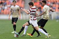 Houston, TX - Friday December 11, 2016: Luis Argudo (2) of the Wake Forest Demon Deacons and Foster Langsdorf (2) of the Stanford Cardinal battle for control of the ball at the NCAA Men's Soccer Finals at BBVA Compass Stadium in Houston Texas.