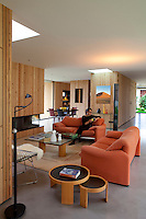 The young owner of the property enjoys the comfort of one of the contemporary sofas in the living area