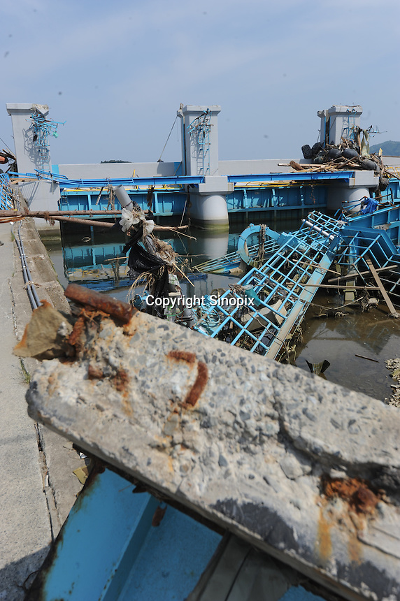 Destroyed Tsunami gates at Minamisanriku, Myiagi, Japan. The fishing port of Minamisanriku, Miyagi, Japan was devastated by the tsunami where the popultion was reduced from 18,000 to about 8,000