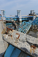 Destroyed Tsunami gates at Minamisanriku, Myiagi, Japan. The fishing port of Minamisanriku, Miyagi, Japan was devastated by the tsunami where the popultion was reduced from 18,000 to about 8,000