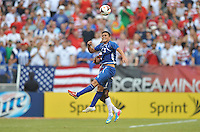 Rodolfo Zelaya (11) of El Salvador heads the ball. The USMNT defeated El Salvador 5-1 at the quaterfinal game of the Concacaf Gold Cup, M&T Stadium, Sunday July 21 , 2013.