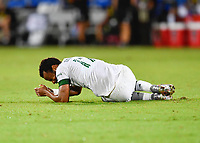 LAKE BUENA VISTA, FL - AUGUST 01: An injured Jeremy Ebobisse #17 of the Portland Timbers lies on the ground during a game between Portland Timbers and New York City FC at ESPN Wide World of Sports on August 01, 2020 in Lake Buena Vista, Florida.