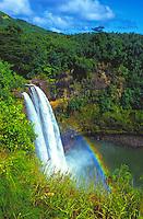 Easily accessible, 80-foot Wailua Falls surrounded by lush vegetation on the island of Kauai