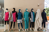 A range of burkinis on sale in a shop at the Selge Beach resort. The hotel is one of many halal hotels catering to the religiously observant Muslim tourist.