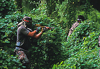 Two men engaged in paintball sport, a paramilitary leisure type game