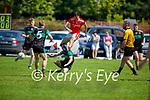 Churchills Ciaran Carmody puts his body on the line as he blocks  St Pats Kieran Dwyers clearance in the County Senior football league on Sunday.