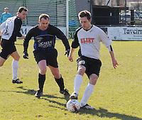 SV Kortrijk - Blauwvoet Otegem ..Stijn Christiaens aan de bal met achter zich Bjorn Bouchart (links)..foto VDB / BART VANDENBROUCKE